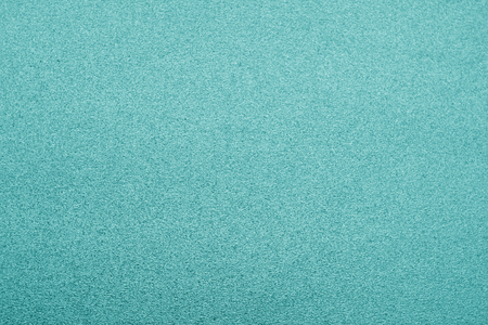 Plastic glittering texture in cyan color. Abstract background and texture for design. Imagens