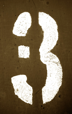 Number 3 in stencil on metal wall in brown tone. Abstract background and texture for design.
