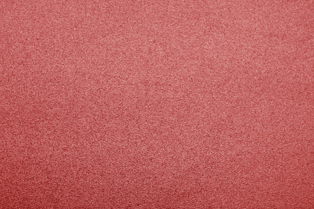 Plastic glittering texture in red color. Abstract background and texture for design.