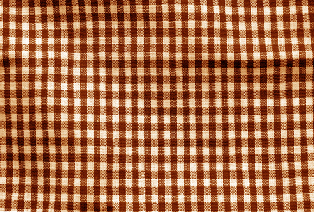 Checked fabric texture in orange tone. Abstract background and texture for design. Banque d'images
