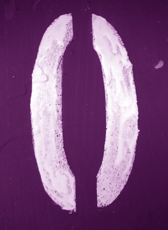 Number 0 in stencil on metal wall in purple tone. Abstract background and texture for design.