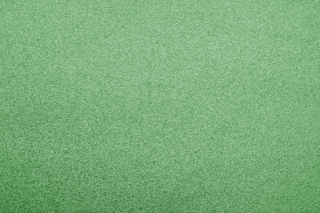 Plastic glittering texture in green color. Abstract background and texture for design.
