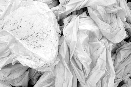 Dirty crumpled pvc in black and white. Abstract background and texture for design.