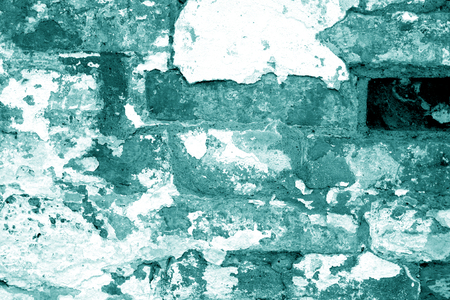 Old grungy brick wall texture in cyan tone. Abstract architectural background and texture for design.