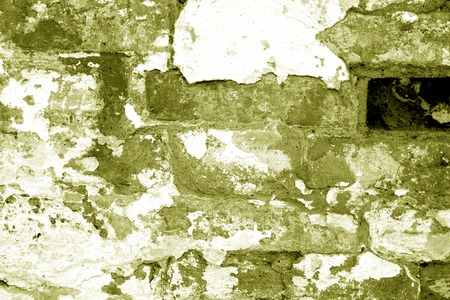 Old grungy brick wall texture in yellow tone. Abstract architectural background and texture for design. Stockfoto