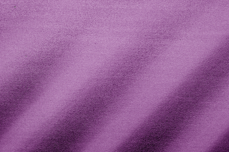Plastic glittering texture in purple tone. Abstract architectural background and texture for design.