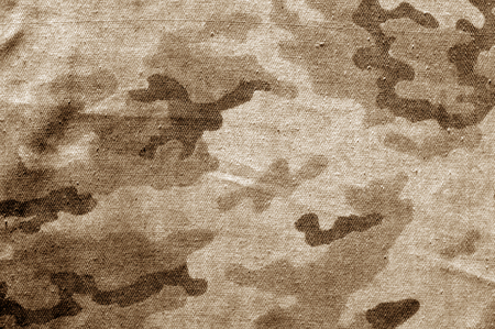 Dirty camouflage cloth in brown tone. Abstract background and texture for design abd ideas. Stok Fotoğraf