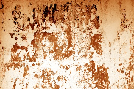 Ñraked weathered cement wall texture in orange tone. Abstract background and texture for design.
