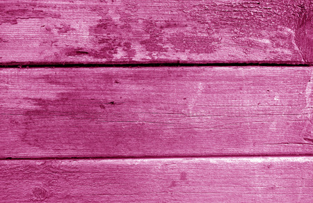 Weathered wooden painted wall in pink tone. Abstract background and texture for design.