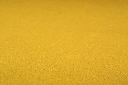 Yellow color plastic glittering texture with blur effect. Abstract background and texture for design. Banco de Imagens