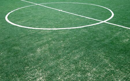 Fragment of footbal field with artificial grass. Sports background.