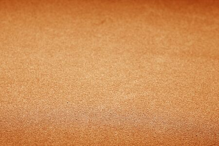 Plastic glittering texture with blur effect in orange color. Abstract background and texture for design.