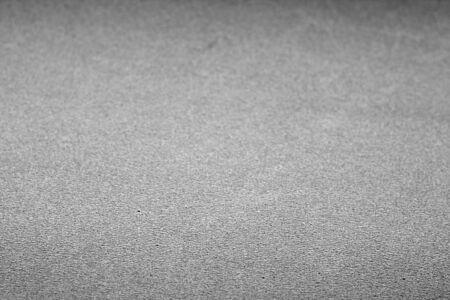 Plastic glittering texture with blur effect in black and white. Abstract background and texture for design.