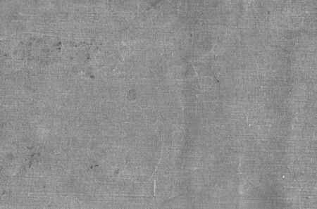 Old grungy canvas pattern with dirty spots in black and white. Abstract background, texture, surface for any design.