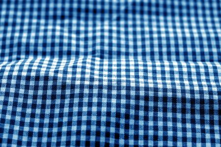 Checked fabric texture in blur effect in navy blue tone. Abstract background and texture for design. Banque d'images