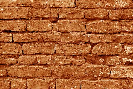 Old grungy brick wall texture in orange tone. Abstract architectural background and texture for design. Stockfoto