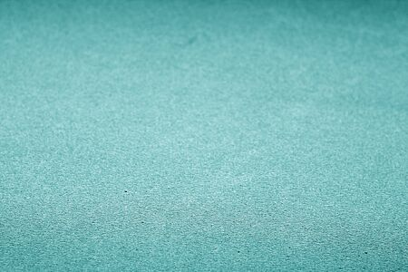Plastic glittering texture with blur effect in cyan color. Abstract background and texture for design.