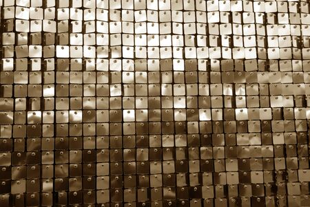 Glittering background in brown tone. Abstract background and texture for design. Stock Photo
