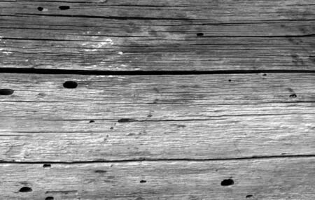 Old grunge wooden fence pattern in black and white. Abstract background and texture for design. Stock Photo