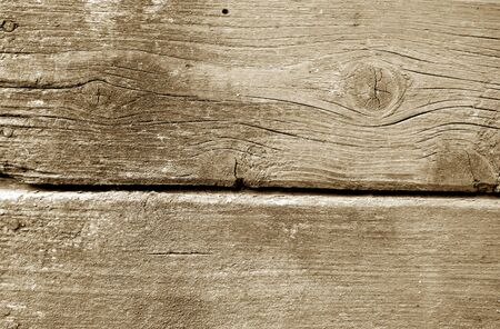 Weathered wooden painted wall in brown color. Abstract background and texture for design. Stock Photo