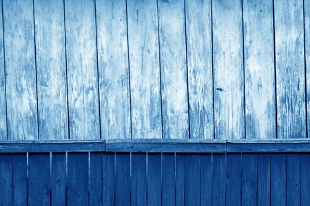 Old grunge wooden fence and wooden wall pattern in navy blue tone. Abstract background and texture for design. Stock Photo