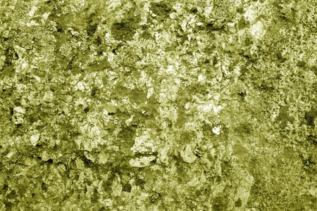 Old stone surface in yellow tone. Abstract architectural background and texture for design.