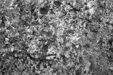 Old stone surface in black and white. Abstract architectural background and texture for design.