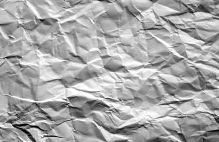 Crumpled sheet of paper with blur effect in black and white. Abstract background and texture for design.