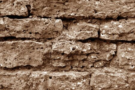 Old grungy brick wall texture in brown tone. Abstract architectural background and texture for design. 版權商用圖片