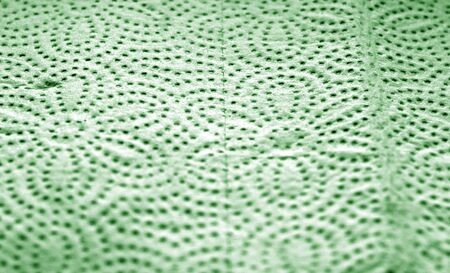 Paper towel surface with blur effect in green color. Abstract background and texture for design. Stock Photo
