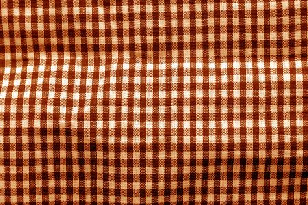 Checked fabric texture in orange tone. Abstract background and texture for design. Stock Photo