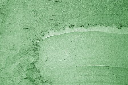 Grungy cement wall texture in green color. Abstract background and pattern for design. Stock Photo