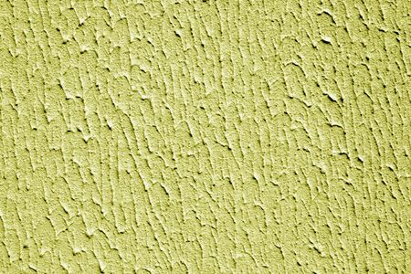 Plaster wall texture with interesting pattern in yellow color. Abstract architectural background and texture for design.
