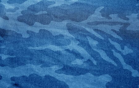 Dirty camouflage cloth with blur effect in navy blue tone. Abstract background and texture for design abd ideas. Imagens