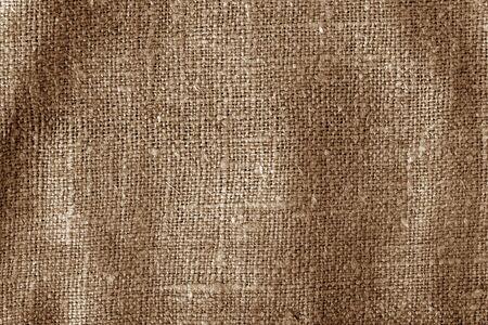 Texture de tissu de sac avec effet de flou de couleur marron. Abstrait et texture.