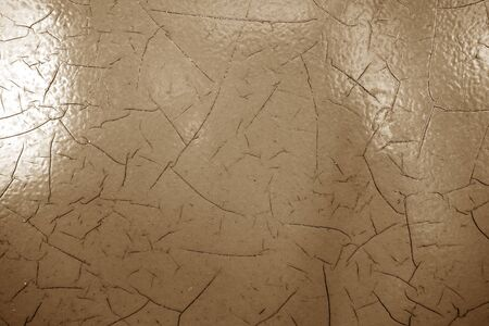 Cracked paint texture in brown color. Abstract architectural background and texture for design. Imagens