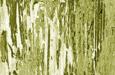 Weathered painted wooden wall in yellow tone. Abstract background and texture for design.