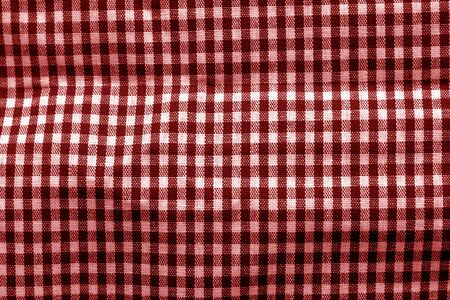 Checked fabric texture in red tone. Abstract background and texture for design.