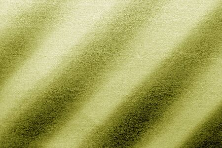 Plastic glittering texture in yellow tone. Abstract architectural background and texture for design.