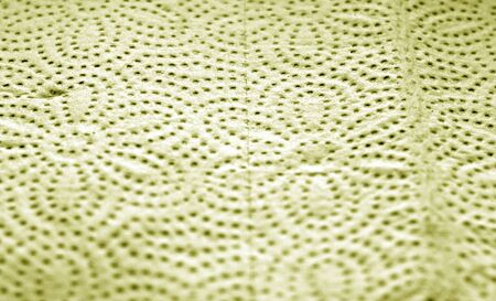 Paper towel surface with blur effect in yellow color. Abstract background and texture for design.