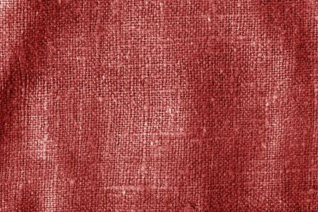 Sack cloth texture with blur effect in red color. Abstract background and texture.
