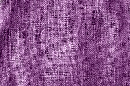 Sack cloth texture with blur effect in purple color. Abstract background and texture.