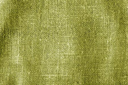 Sack cloth texture with blur effect in yellow color. Abstract background and texture.