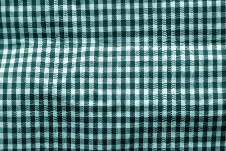 Checked fabric texture in cyan tone. Abstract background and texture for design.