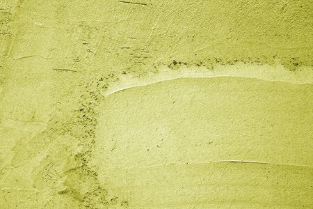 Grungy cement wall texture in yellow color. Abstract background and pattern for design.