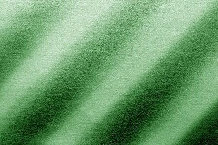 Plastic glittering texture in green tone. Abstract architectural background and texture for design.