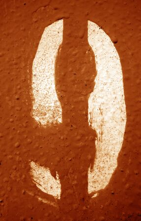 Number 9 in stencil on metal wall in orange tone. Abstract background and texture for design.