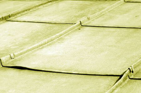 Old metal roof in yellow tone. Abstract background and texture for design.