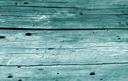 Old grunge wooden fence pattern in cyan tone. Abstract background and texture for design. Banco de Imagens