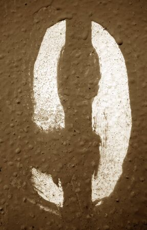 Number 9 in stencil on metal wall in brown tone. Abstract background and texture for design.